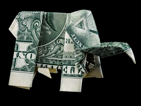 A one dollar bill folded into the shape of an elephant