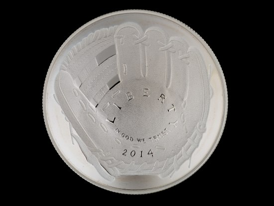 "The reverse side of a silver coin. It has a baseball glove on it and the inscription ""Liberty In God we trust 2014"