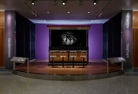 Photograph of a section of the Greensboro Woolworth's lunch counter, on display in the museum's Unity Square.