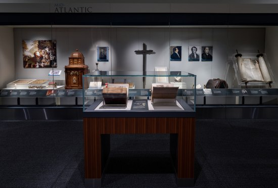 """Photograph of the interior of the """"Religion in Early America"""" exhibition."""
