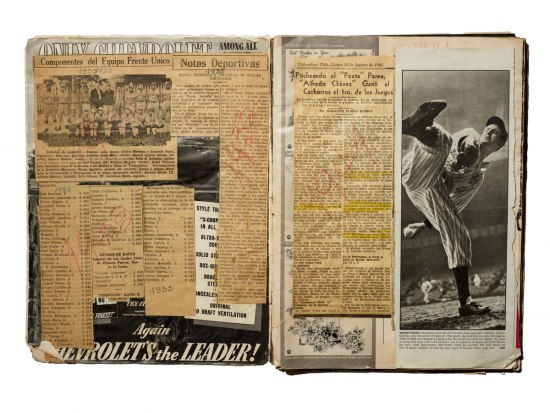 "Interior photo of Martinez's LIFE magazine scrapbook. A large photograph of  Yankees pitcher Vernon ""Lefty"" Gomez in the middle of a pitch covers most of the page."