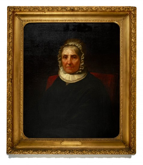 An old woman, Eliza Hamilton appears seated in her portrait, wearing black, a white ruffle collar, and a bonnet. The portrait is in a gold frame.