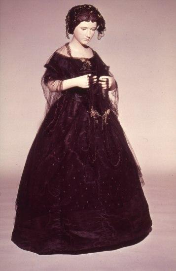 Jane Pierce's black tulle dressed posed on a mannequin.