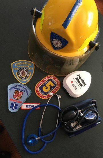 A firefighting helmet, patches, a stethoscope and blood pressure cuff.