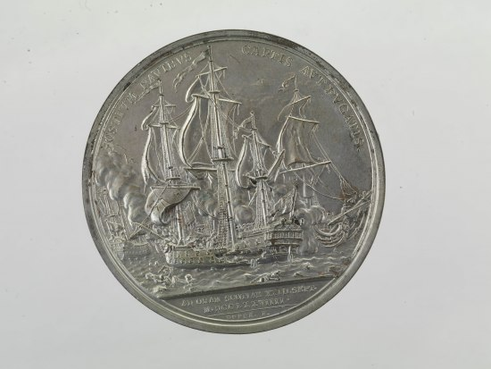 Coin with tall ship with sails