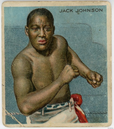 "An old, color playing card in which a man identified as ""Jack Johnson"" appears to be winding up in a boxing ring against a blue background. He is stripped to his waist wearing white pants."