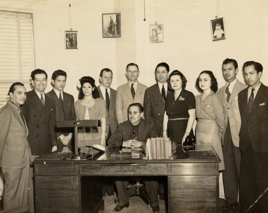 Raoul Cortez, seated, and employees of KCOR Radio, about 1949.