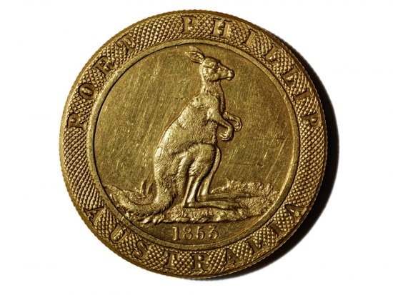Gold colored coin with image of kangaroo