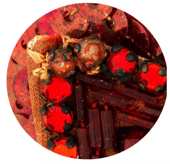 A close-up photo of the beads on the bows of the Ruby Slippers, revealing different types of thread and beads