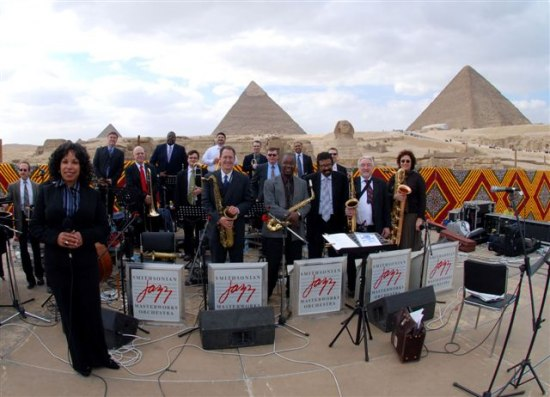 The Smithsonian Jazz Masterworks Orchestra in Egypt, in front of the pyramids.