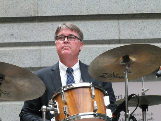 Ken Kimery sits behind his drum set.