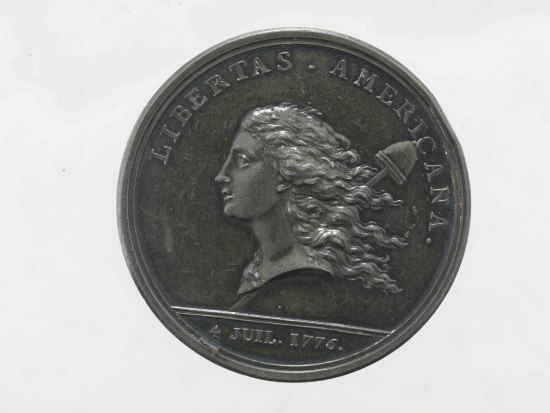 Coin with portrait of a person (perhaps a woman) with long hair