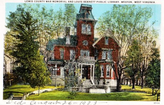 Postcard of a red Victorian-style house surrounded by trees