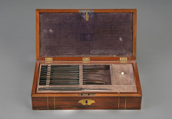Wooden box with surgical tools