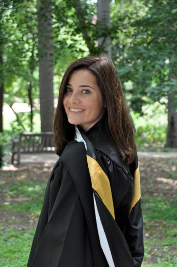 Lindsey Hagan in graduation gown, smiling