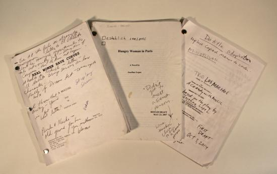 Photograph of three scripts with cursive writing on them
