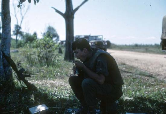 Lt. Doug Miller eating a meal in Vietnam