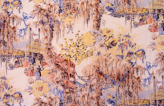 Fabric with colors of cobalt blue, lemon yellow, brick red, white, and light peach. Scenes include a boat, flowers, cotton, and figures.