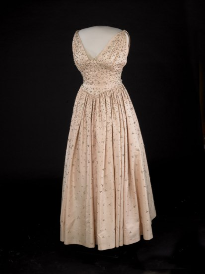 Pink peau de soie gown embroidered with more than 2,000 rhinestones.