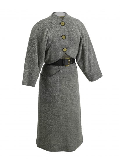 Photo of gray woman's suit. Consists of a skirt, a jacket, and a blouse. Skirt has a slight flare.