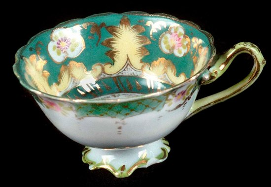 Ornate green and gold cup
