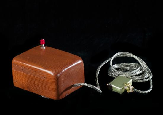Wooden box, red button, cord