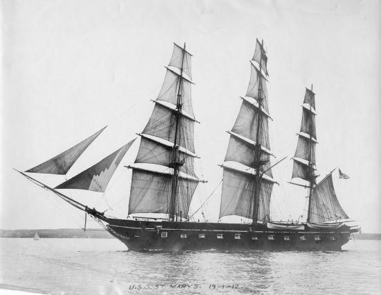 Black and white photo of ship with sails on the water