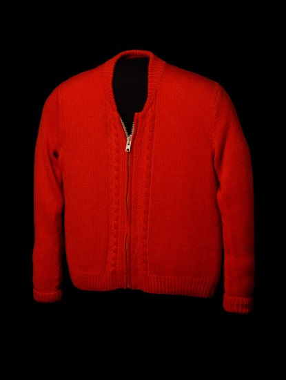 Red cardigan sweater with zipper and detailing around sleeves.
