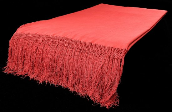 A studio photograph of Susan B. Anthony's red shawl.