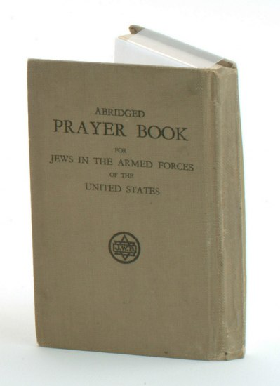 Faded olive green prayer book with title that reads: Abridged Prayer Book for Jews in the Armed Forces of the United States