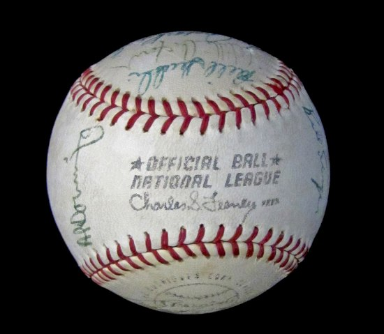 Photo of baseball with red thread. Signatures.