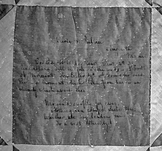 Black and white photo of handwritten message on quilt fabric