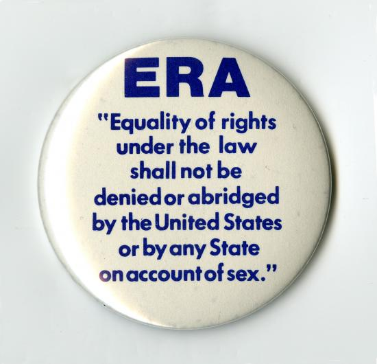 "White pin with blue text. Text reads: ""ERA. 'Equality of rights under the law shall not be denied or abridged by the United States or by any State on account of sex.'"""