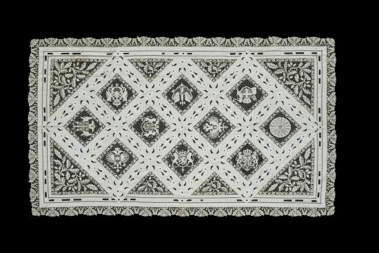 Photo of white lace tablecloth on black background