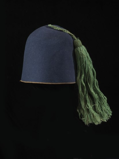 Blue fez hat with green tassel