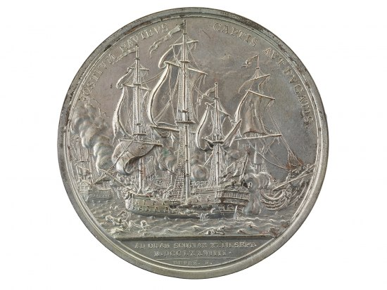 Silver metal with maritime battle scene