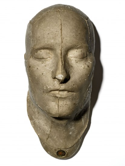 White sculpture-like object showing a man's face, eyes closed. Handsome nose. High forehead. Medium-sized brows. Strong chin and peaceful lips.