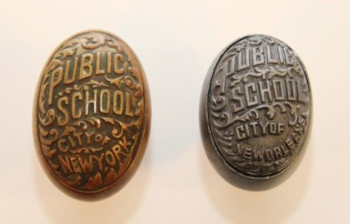 """Photo of two doorknowbs that both say """"Public School"""" with some fancy scrollwork"""