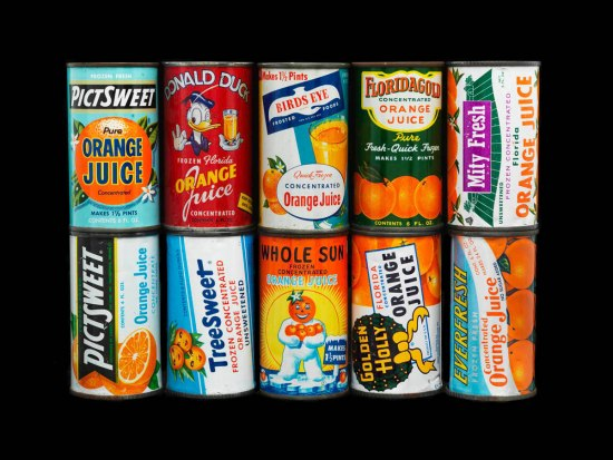 Photo of 12 frozen concentrated orange juice cans, including Donald Duck and Tree Sweet