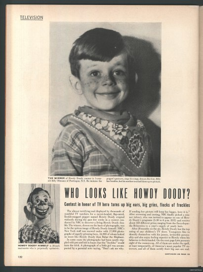 "A page from a magazine with the title ""Who looks like Howdy Doody?"" The top of the page is a photo of a young boy dressed up as the character, with fake freckles and a bandana on. Next to the text lower down on the page is a picture of the puppet itself."