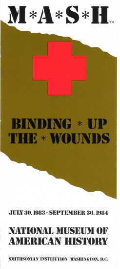 A white rectangular piece of paper positioned vertically with a smear of olive running across it with a red cross and black text.