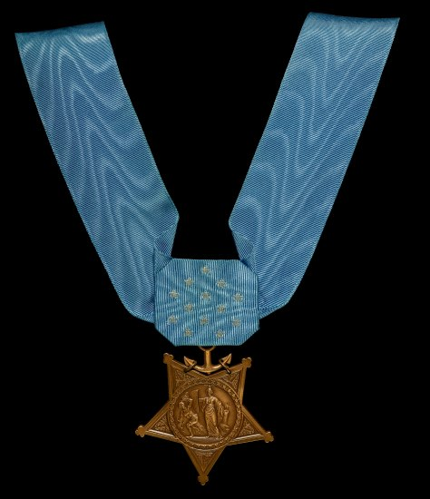 Photograph of Medal of Honor. Blue ribbon with a square-shaped section with many gold stars. Medal is a gold star with anchor and beautiful, intricate image engraved in it, including a robed woman.
