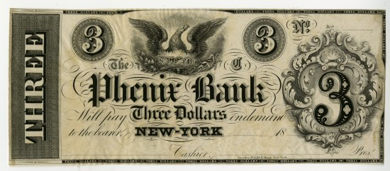"A three dollar bill from Phenix Bank. It is grayish-colored and a phoenix sits at the top near the center, surrounded by calligraphic writing and variations of ""3"" to denote the value"