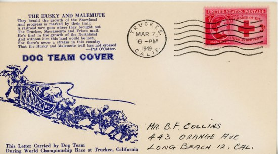 An envelope decorated with an illustration of a musher and a dog sled team in motion