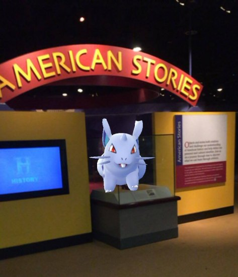 Screen shot from Pokemon game showing purple cartoon Pokemon in museum exhibition