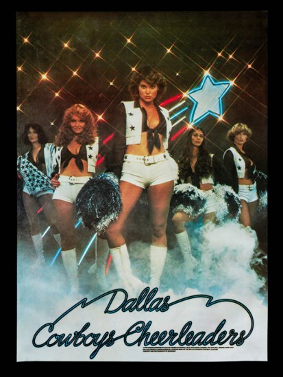 "Poster shows a group of Dallas Cowboys Cheerleaders posing in a line with lights and a large, streaking star in the background. Text at the bottom reads: ""Dallas Cowboys Cheerleaders"""