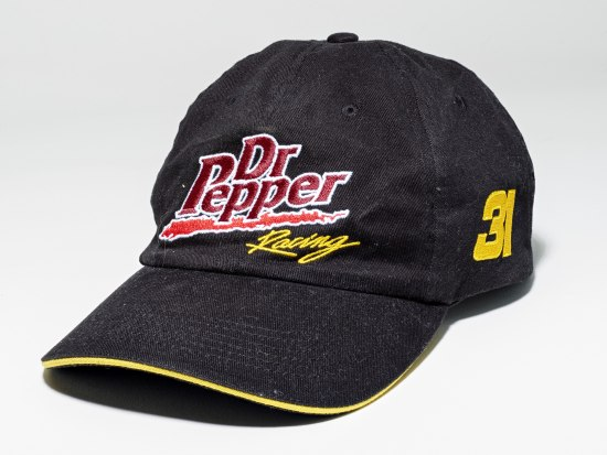 "Black hat with Dr. Pepper logo in red with ""Racing"" in yellow."