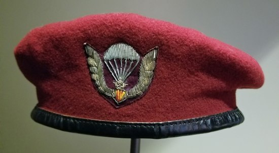 Red beret with stylized image of a parachute and eagle wings