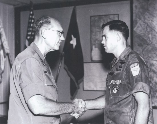 Photograph of Brigadier General Elias C. Townsend and Captain James K. Redding shaking hands