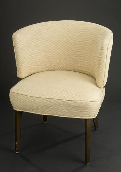 White upholstered chair with brown legs